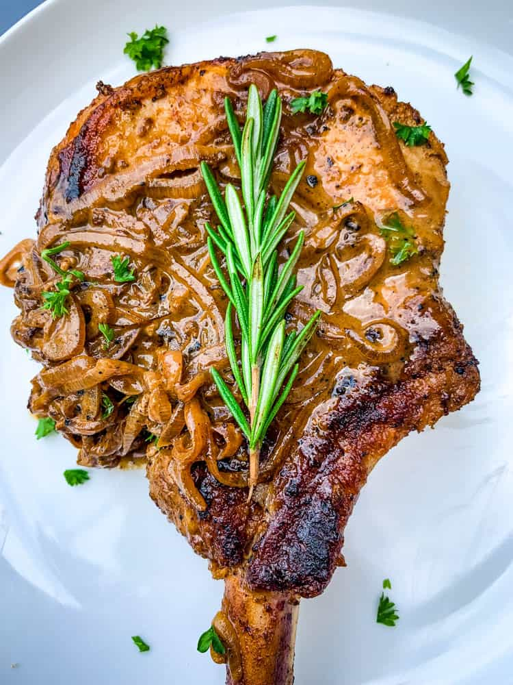 keto smothered pork chops on a white plate