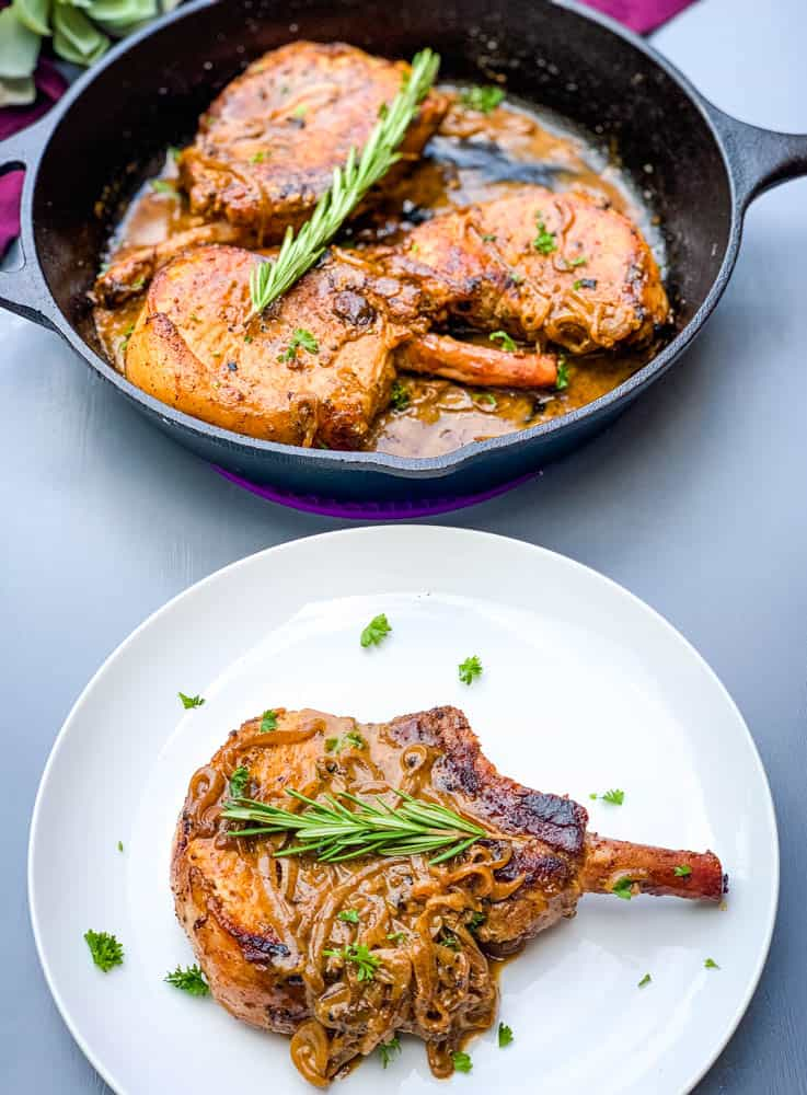 keto low carb smothered pork chops in a cast iron skillet and on a white plate