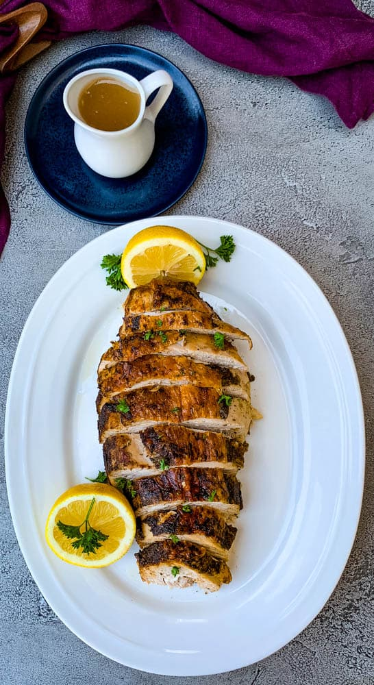 air fryer roasted turkey breast on a white plate