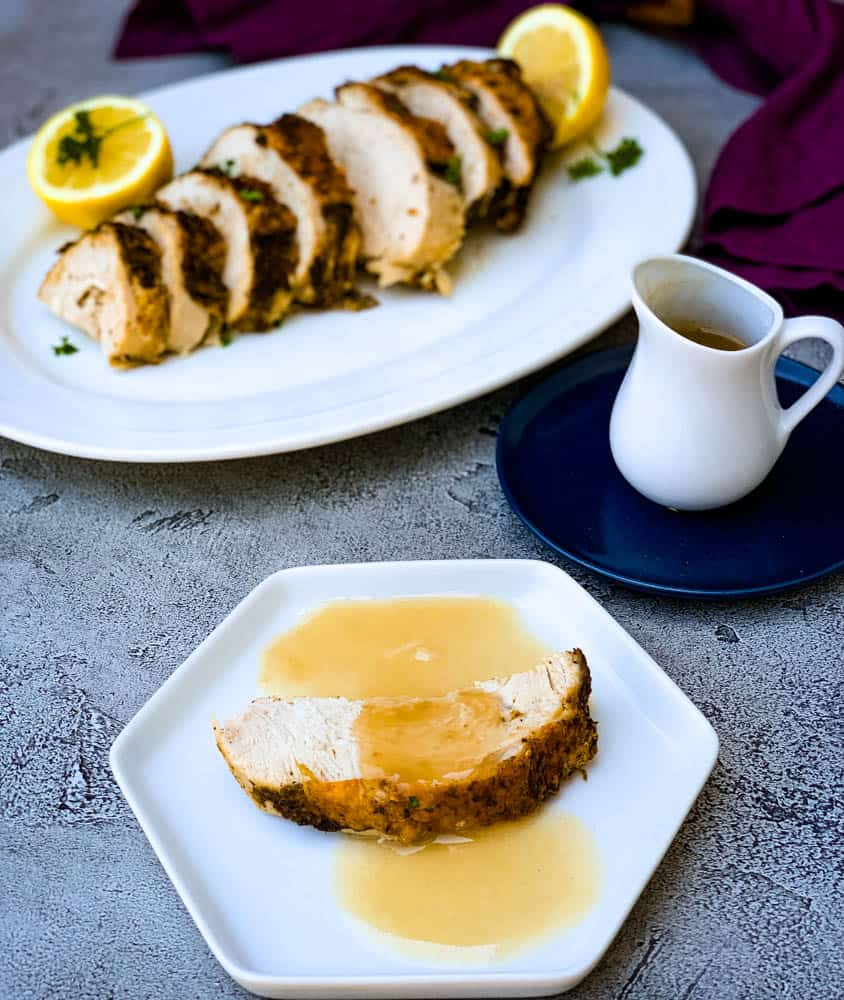 air fryer roasted turkey breast with gravy on a white plate
