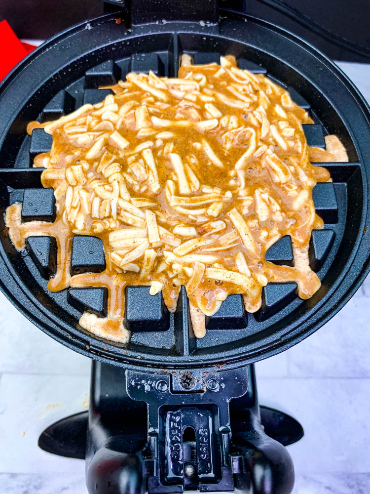 chaffles batter in a waffle iron