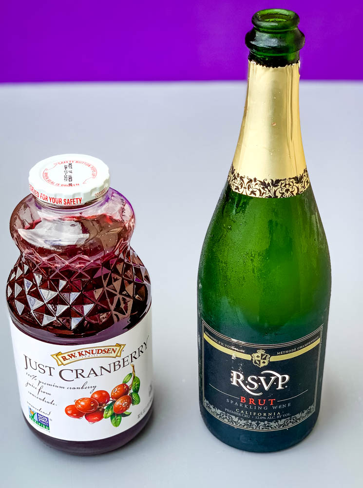 cranberry juice and champagne in bottles