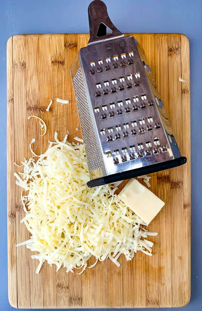 shredded cheese on a cutting board
