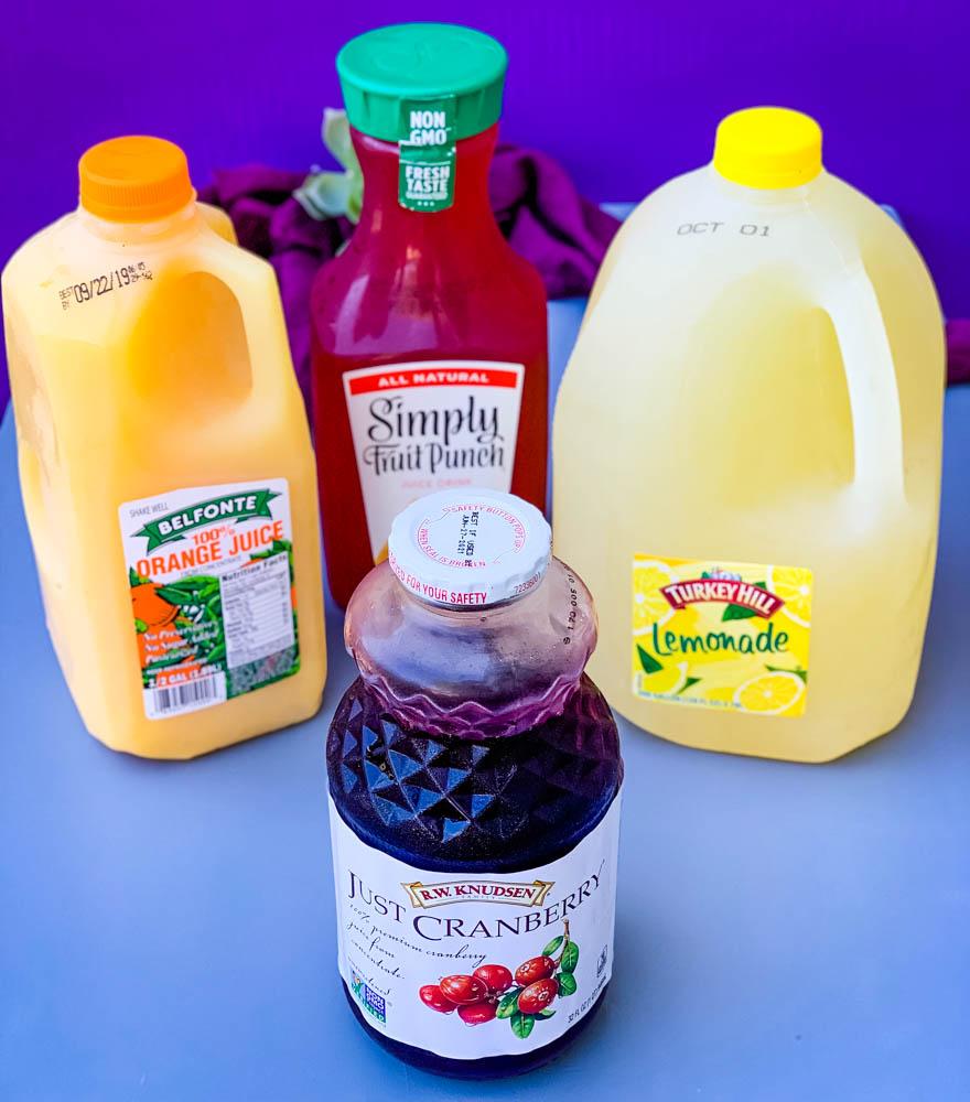 orange juice, lemonade, cranberry juice, and fruit punch in bottles