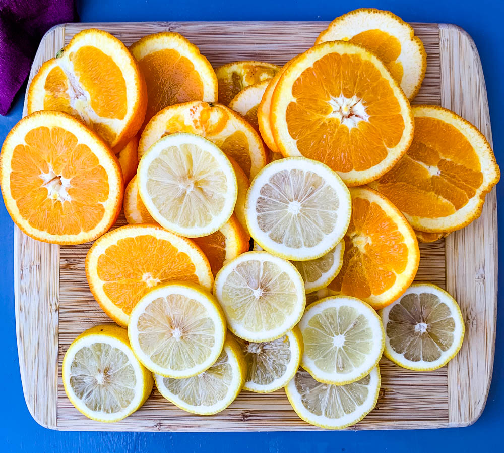 sliced lemons and oranges on a cutting board