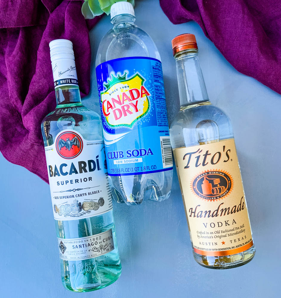vodka, rum, and club soda on a flat surface