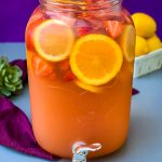jungle juice cocktail recipe in a 2 gallon glass container