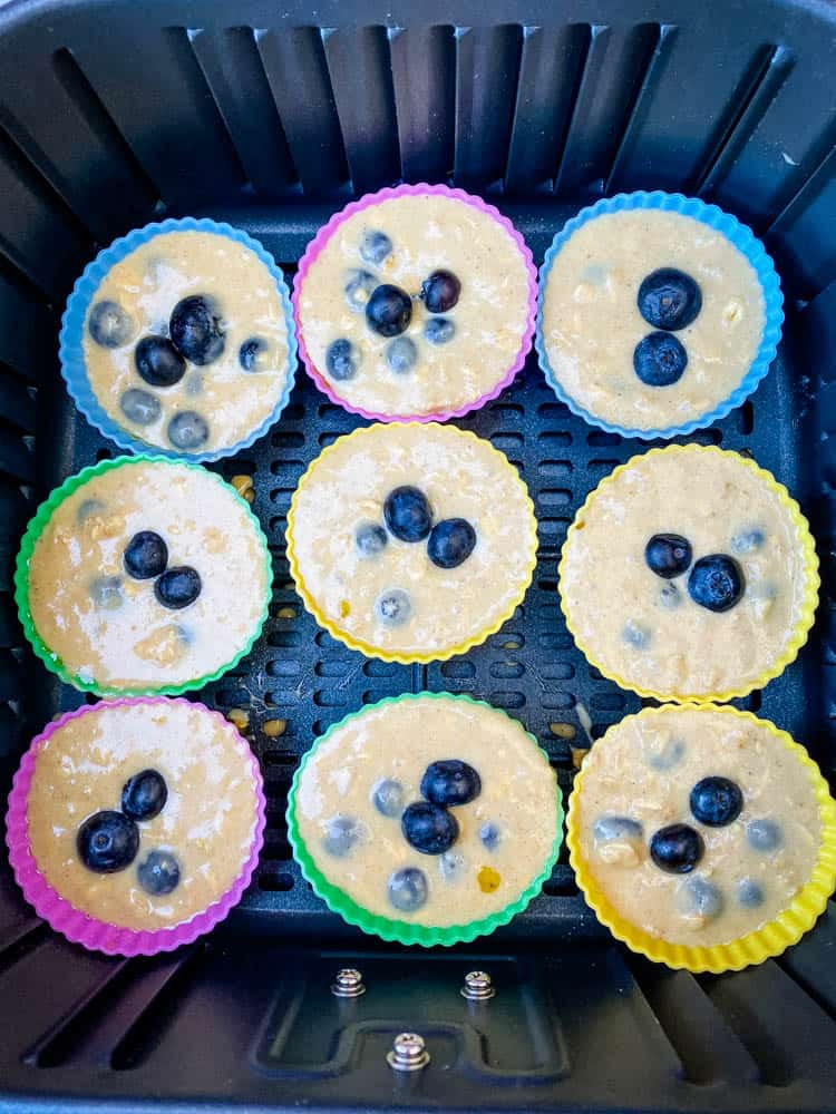 uncooked blueberry muffins in an air fryer