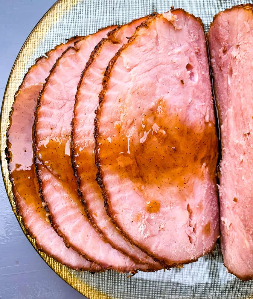 air fryer honey glazed ham on a green and gold plate