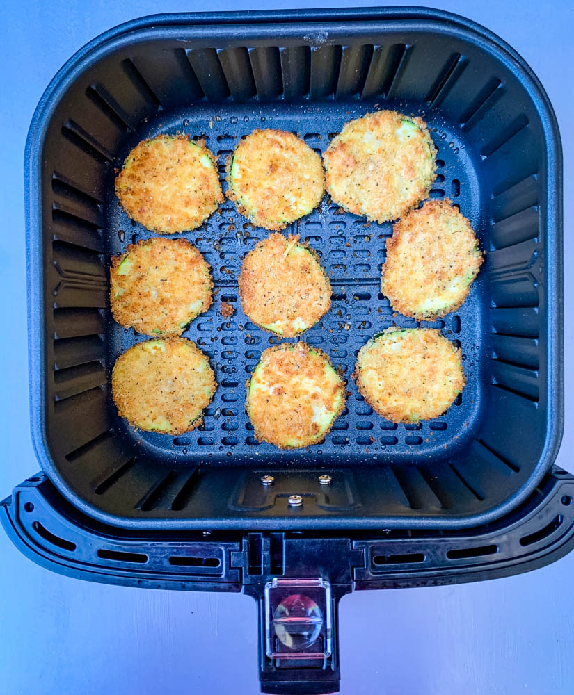 cooked zucchini chips in an air fryer