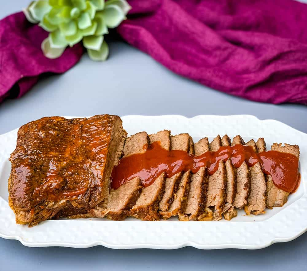 Instant Pot Beef Brisket with BBQ Sauce on a white plate