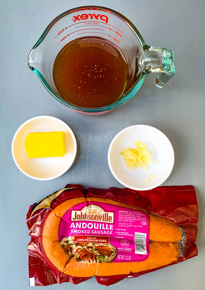 beef broth, butter, garlic, and andouille sausage for Instant Pot Cabbage