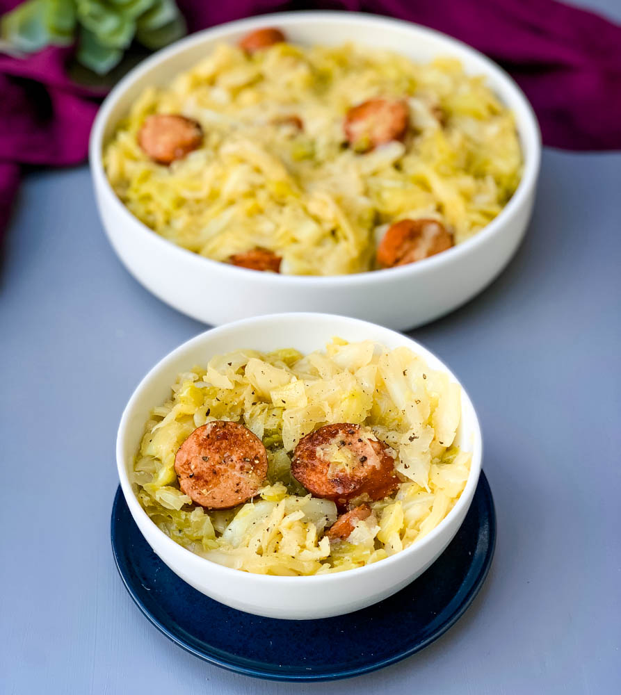 instant pot cabbage and sausage in a white bowl