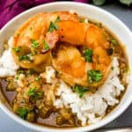 shrimp etouffee with white rice in a white bowl