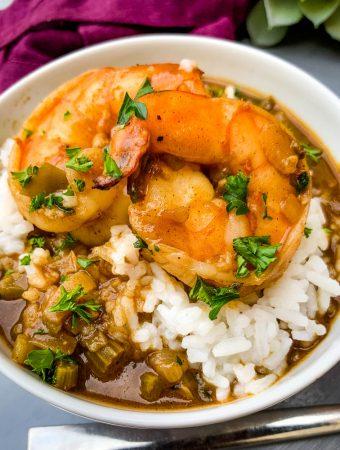 shrimp etouffee with white rice in a white bowl