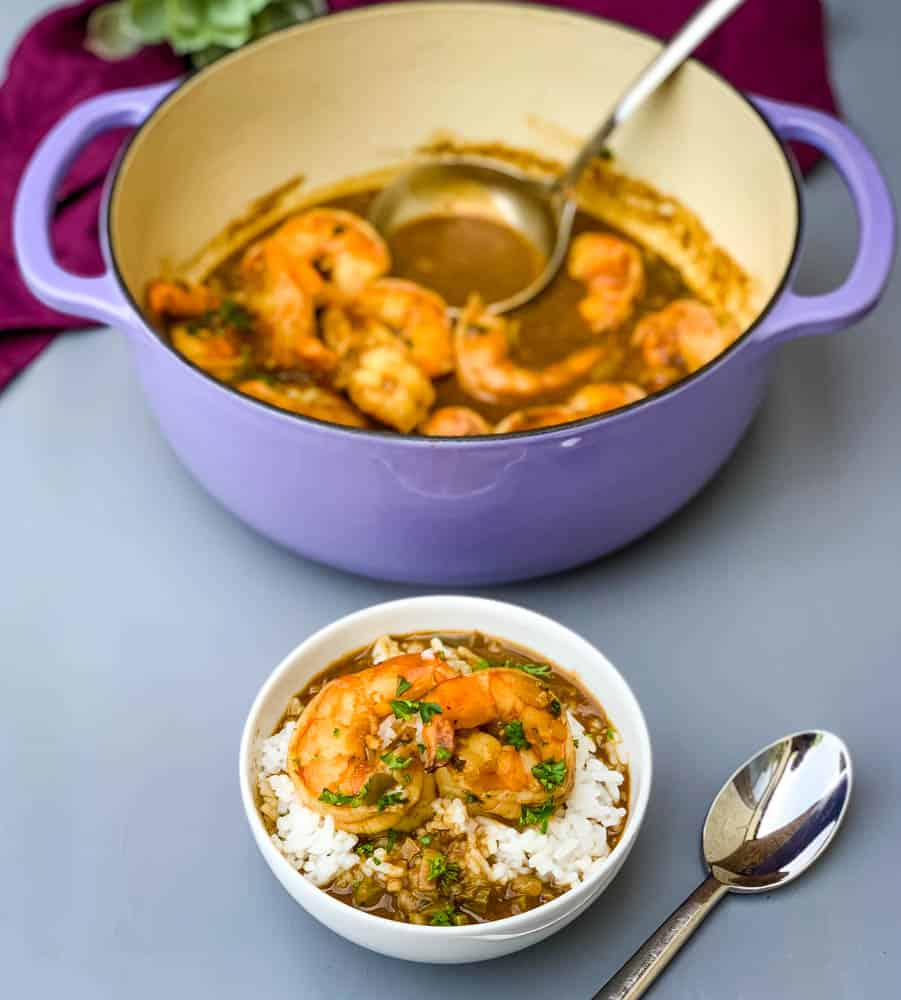 shrimp etouffee in a Dutch oven and in a white bowl