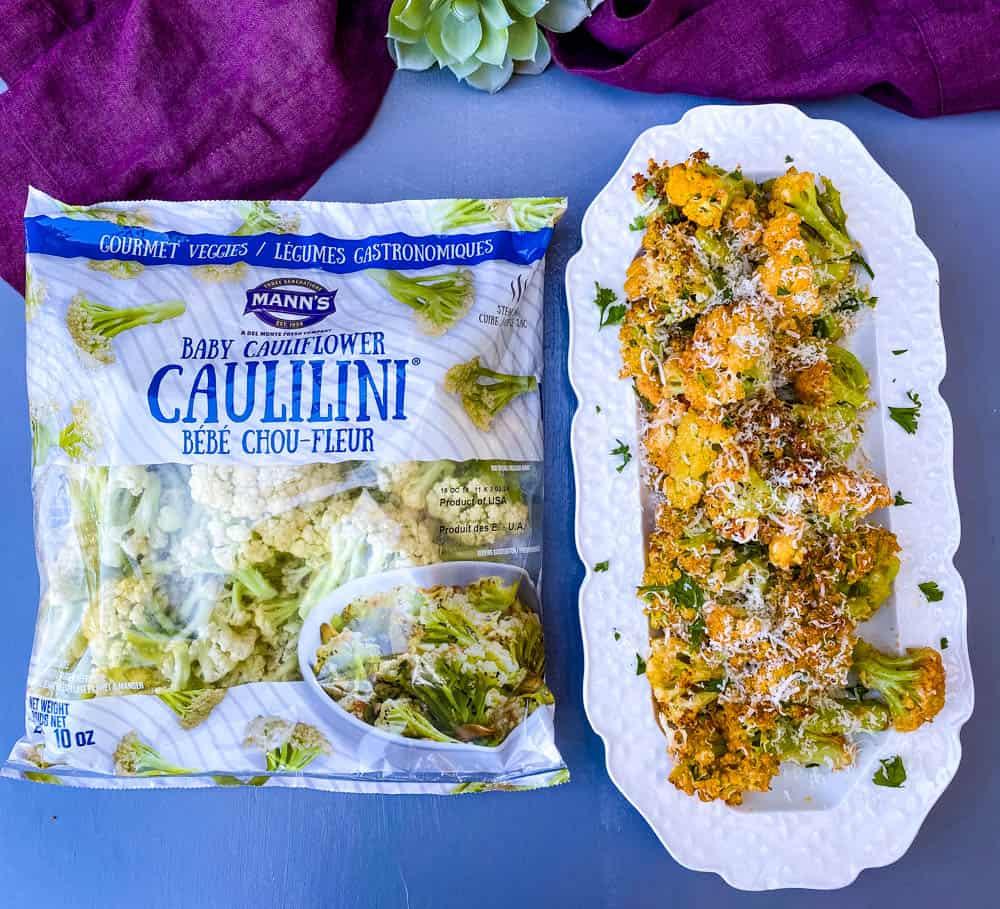 air fryer caulilini on a white plate