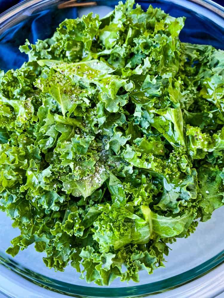 raw kale for air fryer kale chips in glass bowl