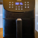 cosori 5.8 quart air fryer on a table