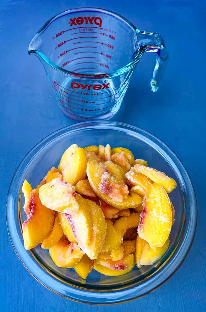 frozen peaches in a glass bowl