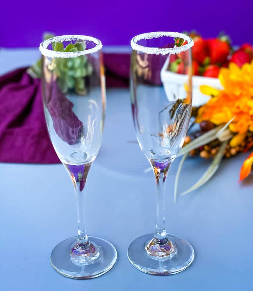 champagne flutes lined with sugar at the rim