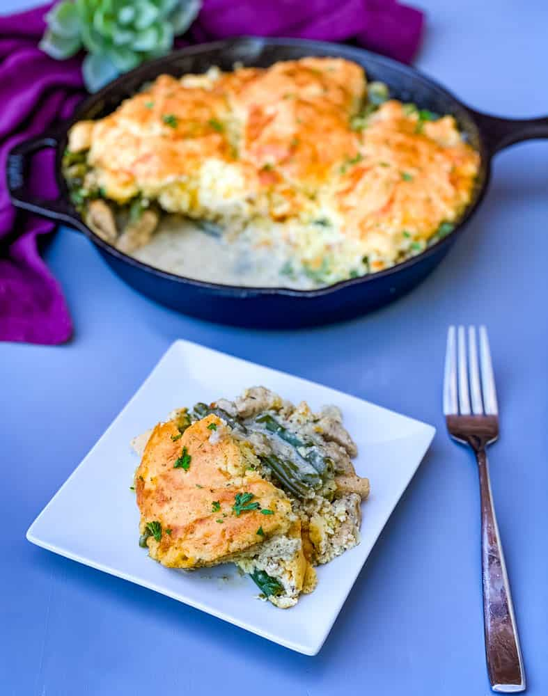a slice of chicken pot pie and keto low carb chicken pot pie in a cast iron skillet