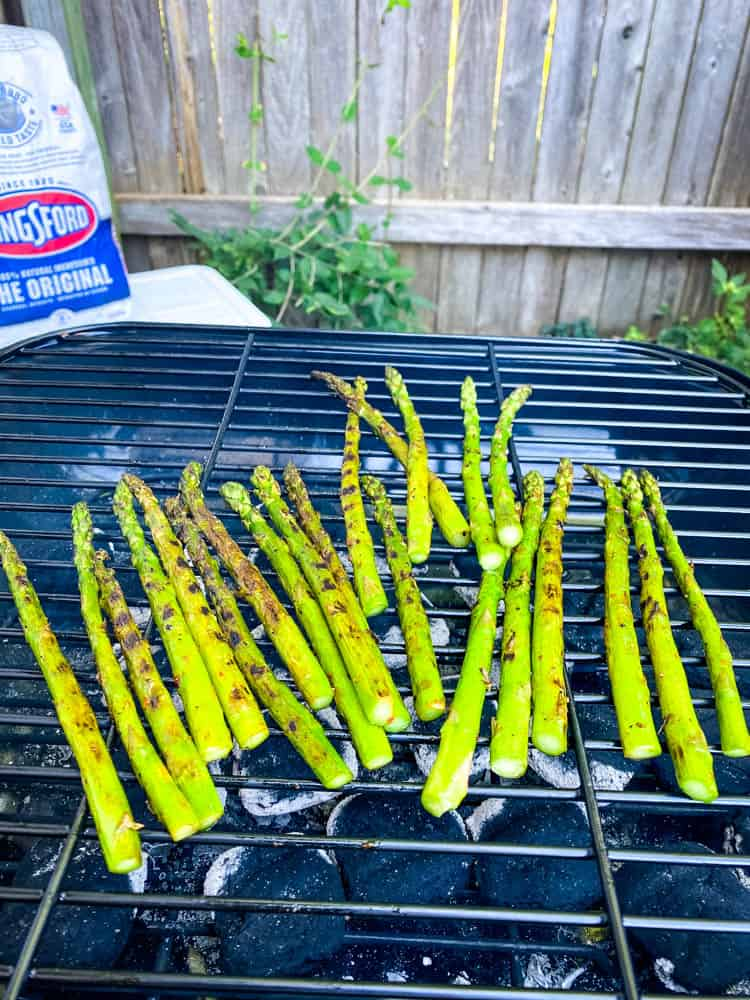 asparagus grilling on a charcoal grill