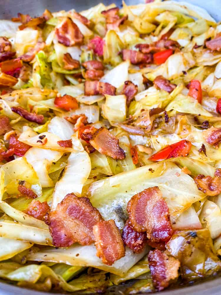 southern fried cabbage with bacon in a stainless steel pan