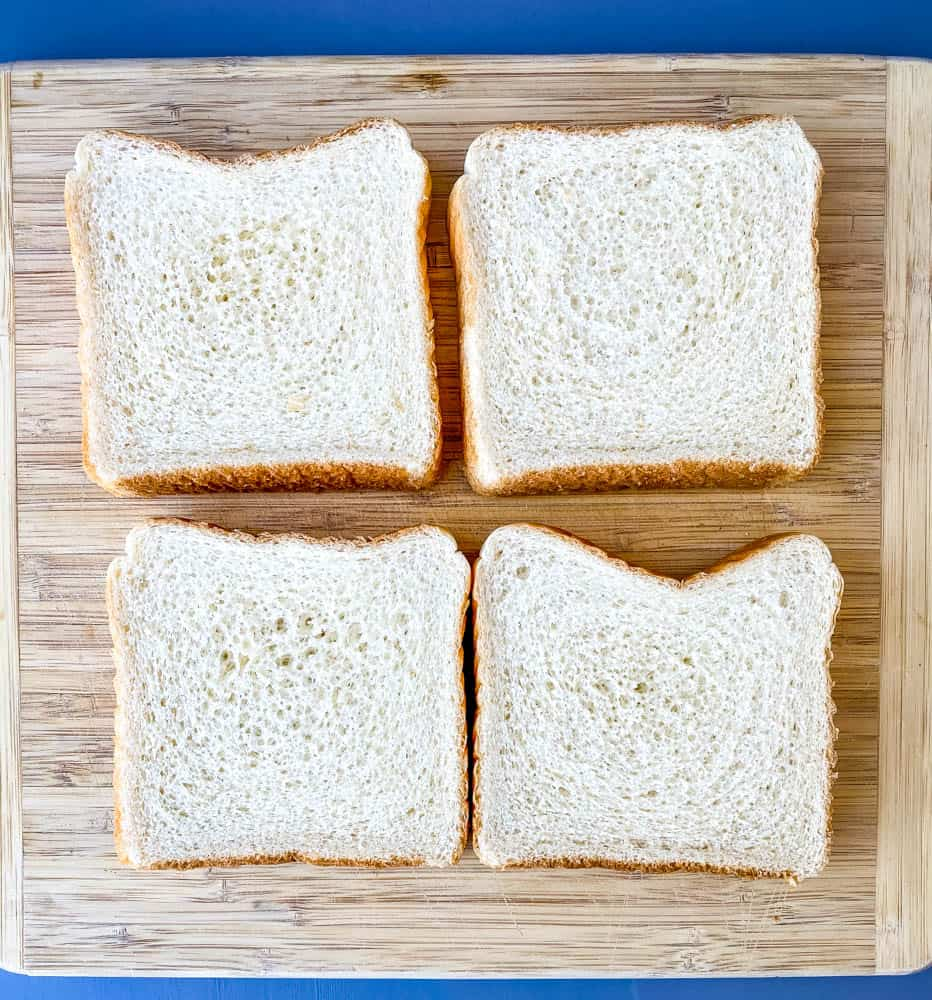 4 slices of Texas toast bread on a wooden cutting board