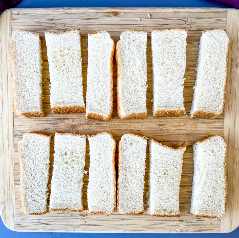 sliced Texas toast bread on a wooden cutting board
