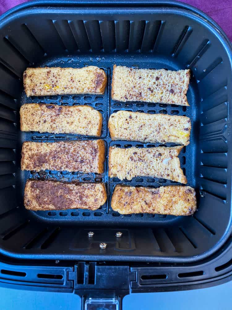 uncooked French toast sticks in an air fryer