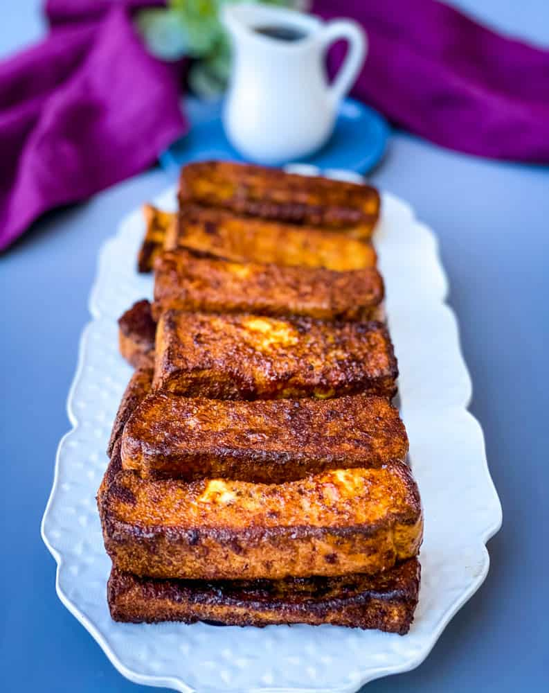 air fryer French toast sticks on a white plate