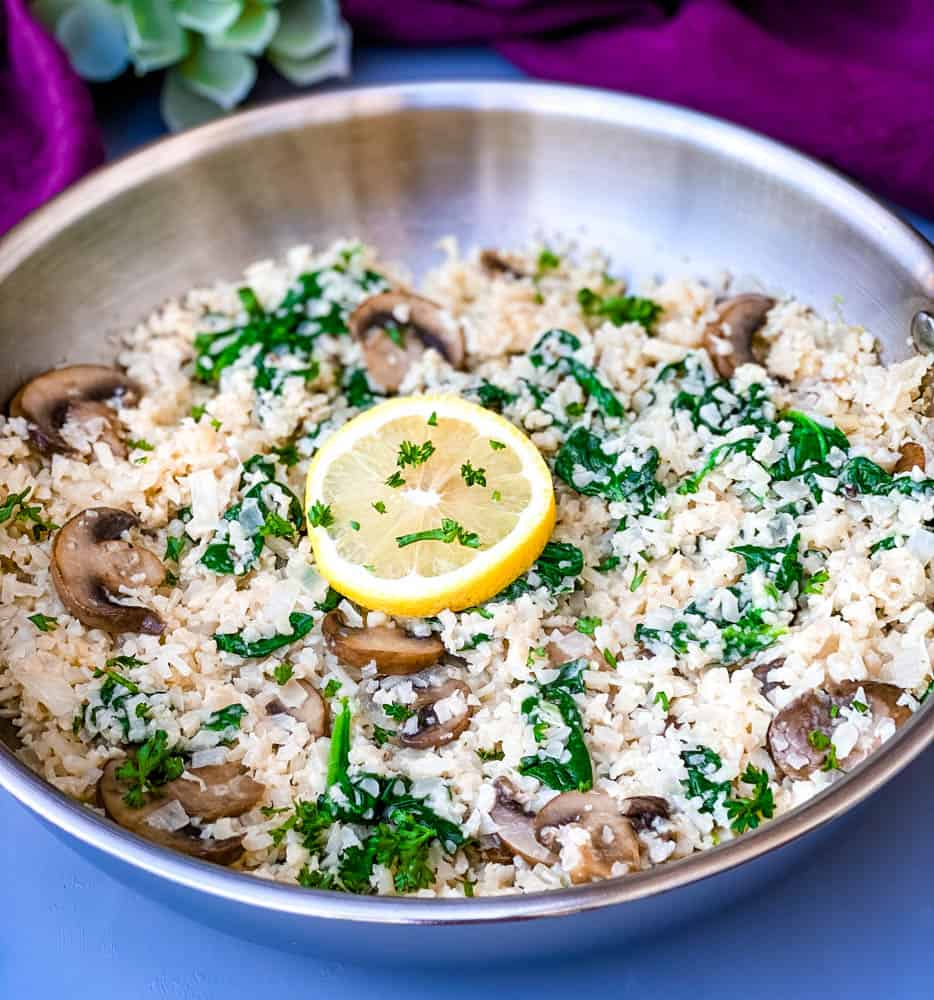 keto low carb cauliflower risotto in a pan with lemon