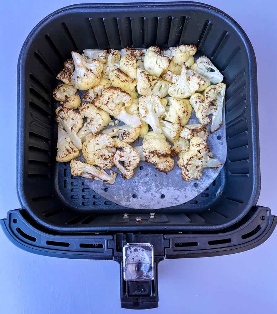 roasted cauliflower in an air fryer basket