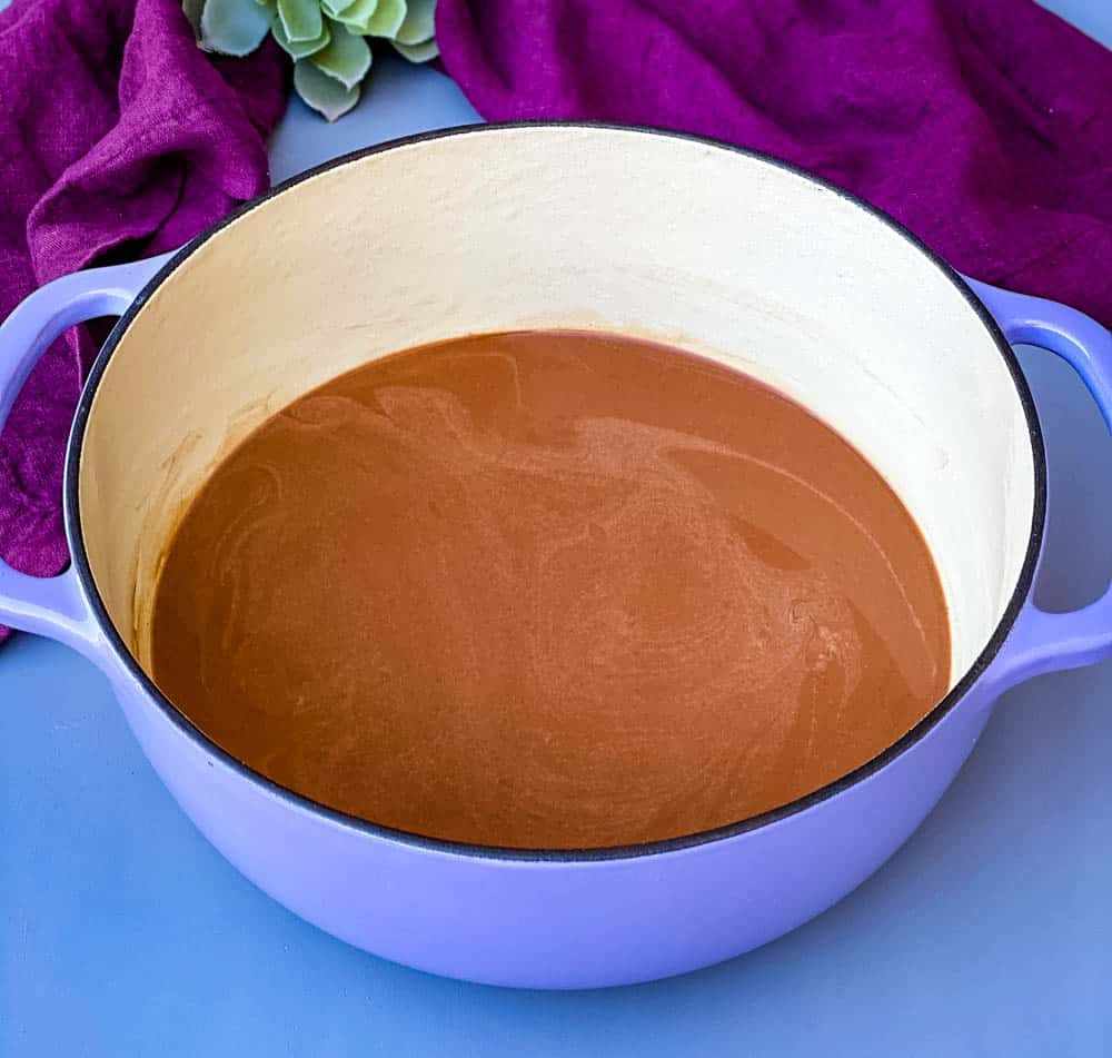 keto low carb hot chocolate in a purple Dutch oven