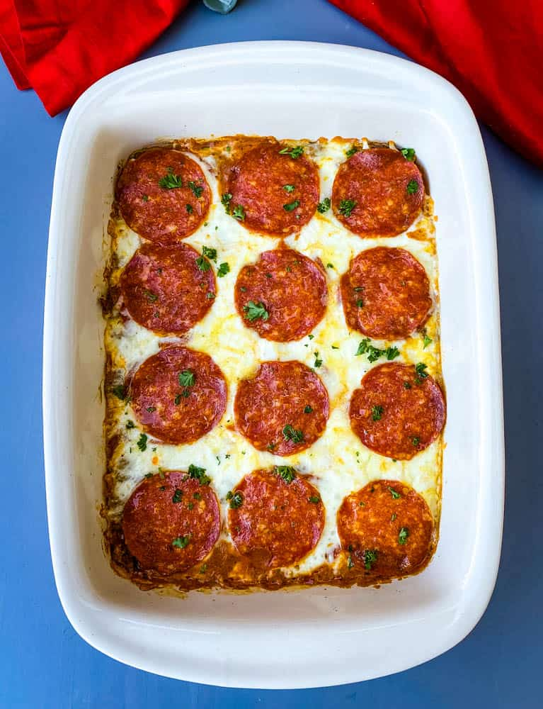 keto low carb pizza casserole in a red dish with a red napkin