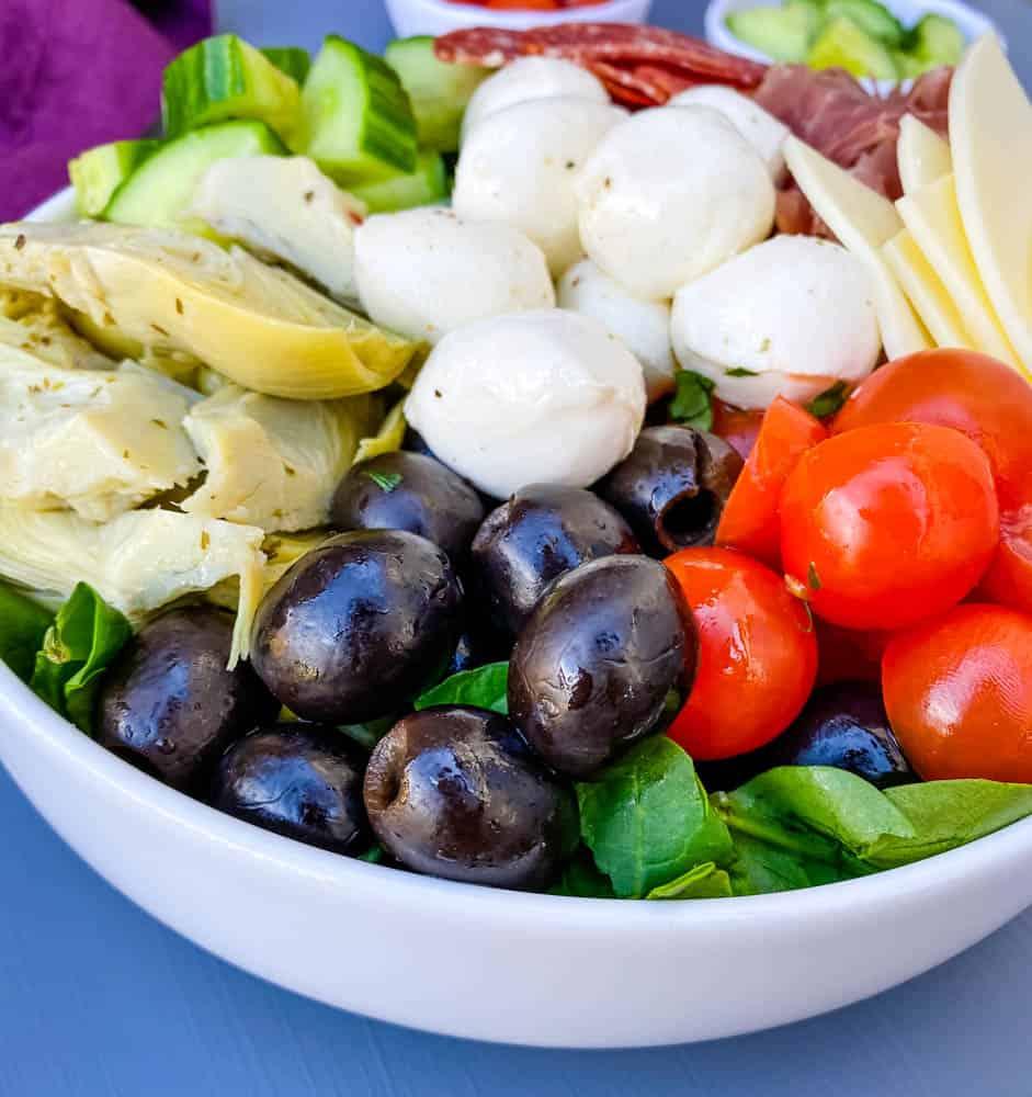 antipasto salad in a white bowl