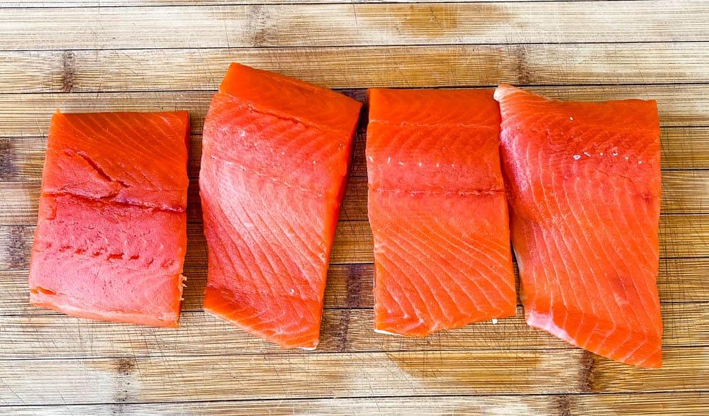 raw wild caught salmon on a cutting board