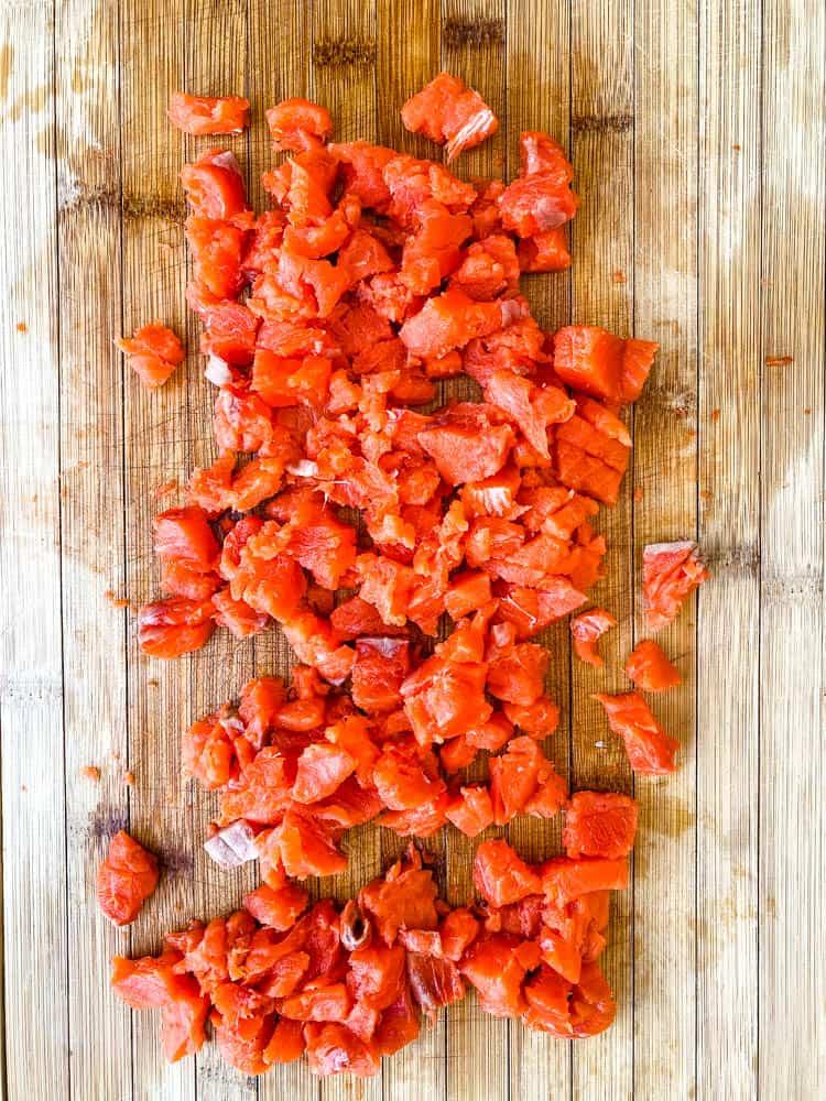 wild caught salmon diced on a cutting board