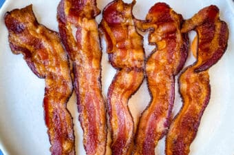 air fryer bacon on a light plate