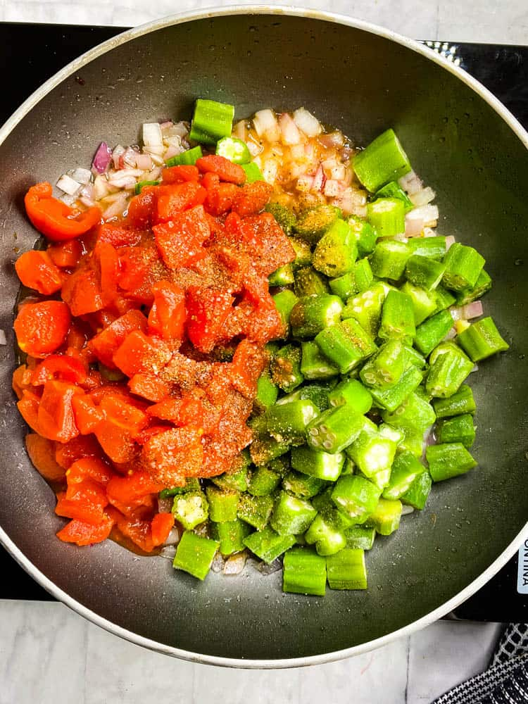 diced tomatoes and frozen okra in a skillet
