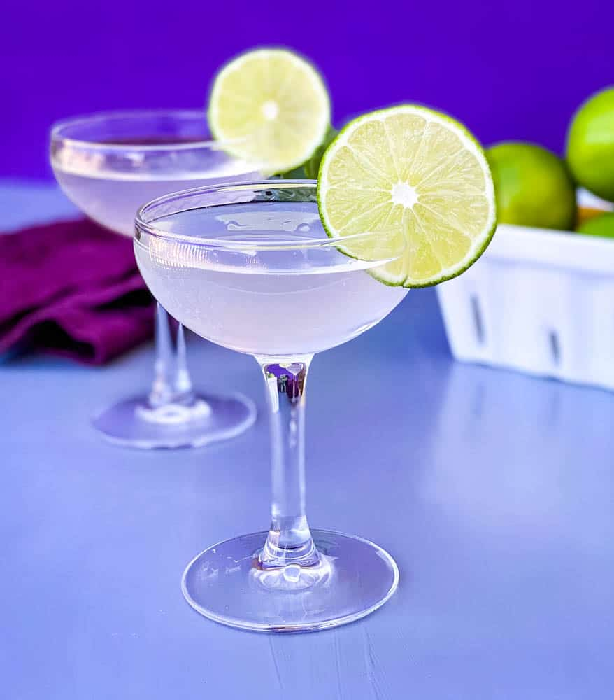 vodka gimlet cocktail in a glass garnished with a fresh lime