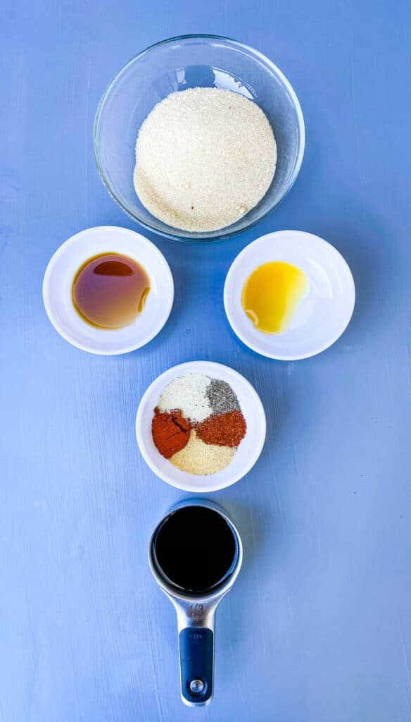 soy sauce, liquid smoke, and worcestershire sauce in separate bowls