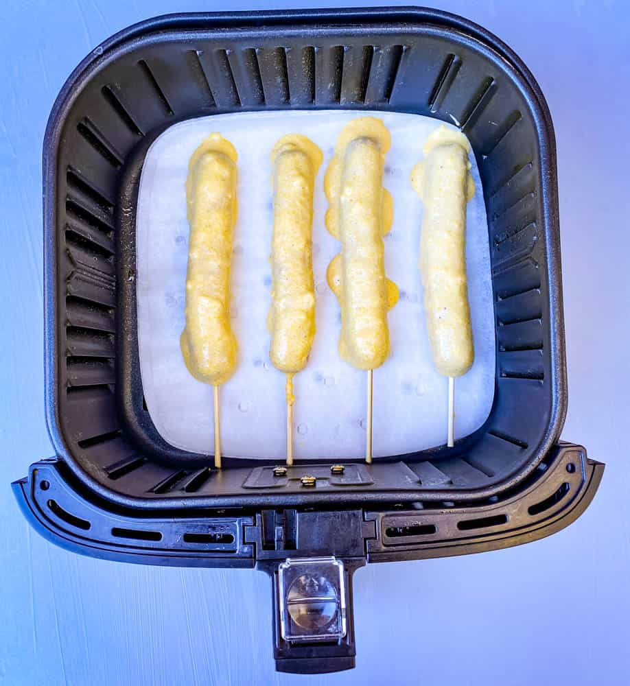 uncooked corn dogs in an air fryer
