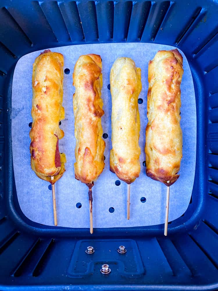 cooked corn dogs in an air fryer