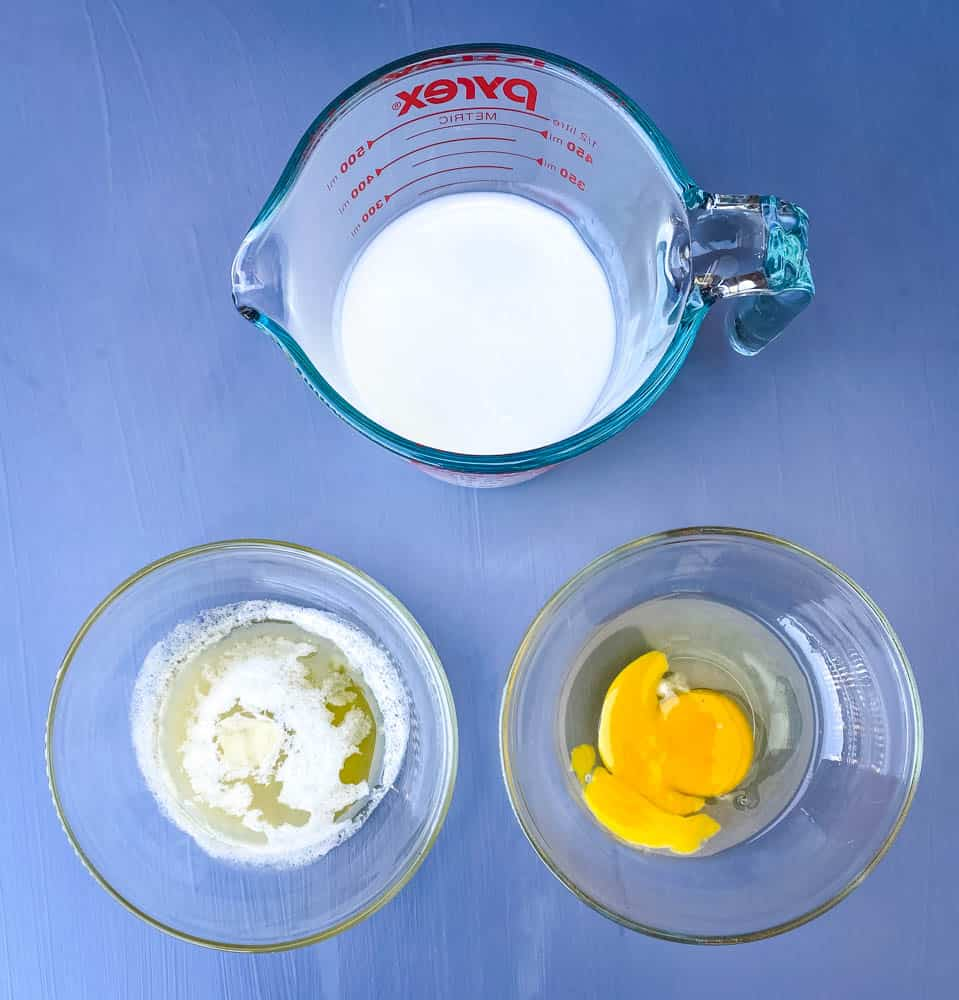 buttermilk, an egg, and melted butter in separate bowls