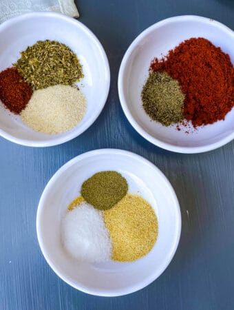 spices for blackened seasoning in 3 individual bowls