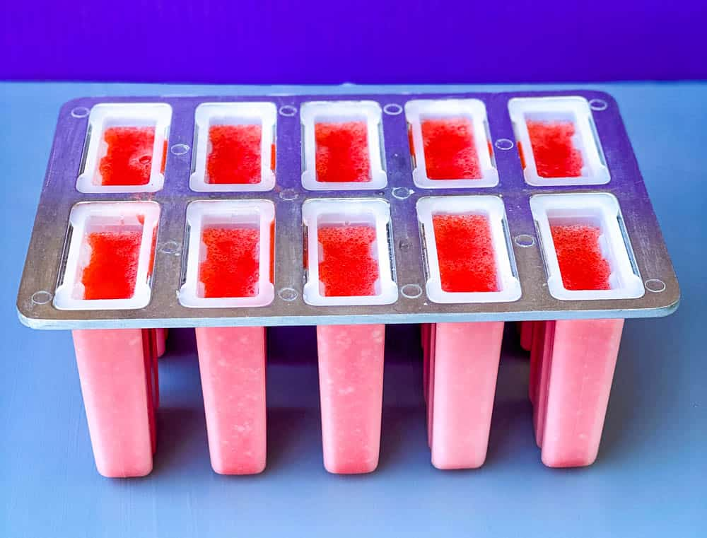 sugar free lemon strawberry mix in a popsicle mold