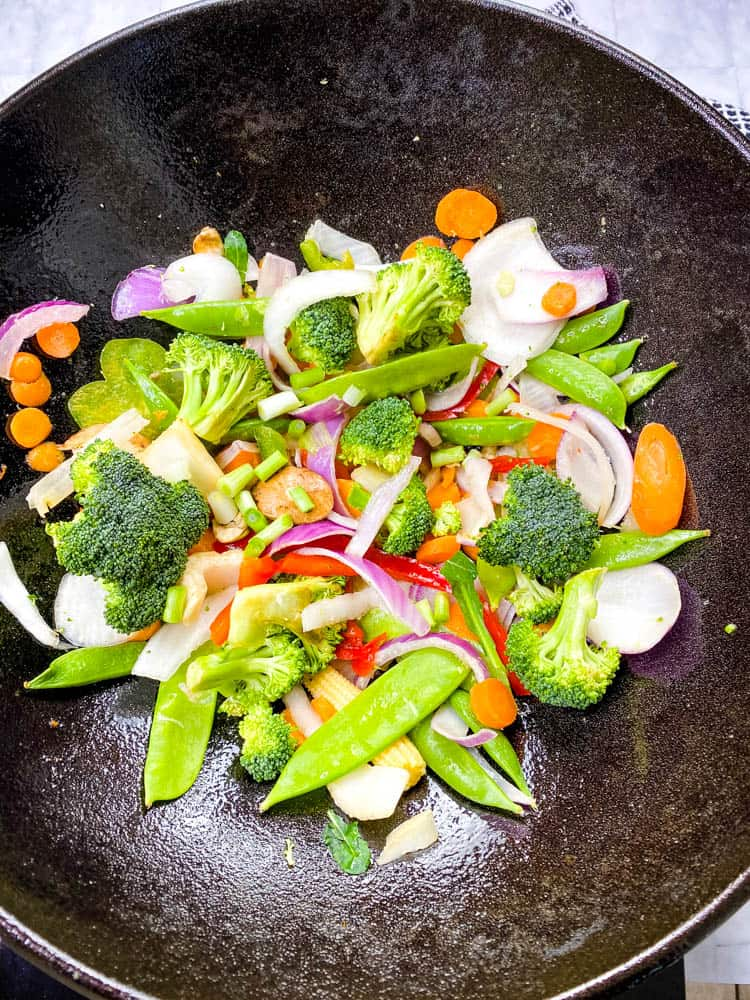 raw vegetables in a cast iron wok