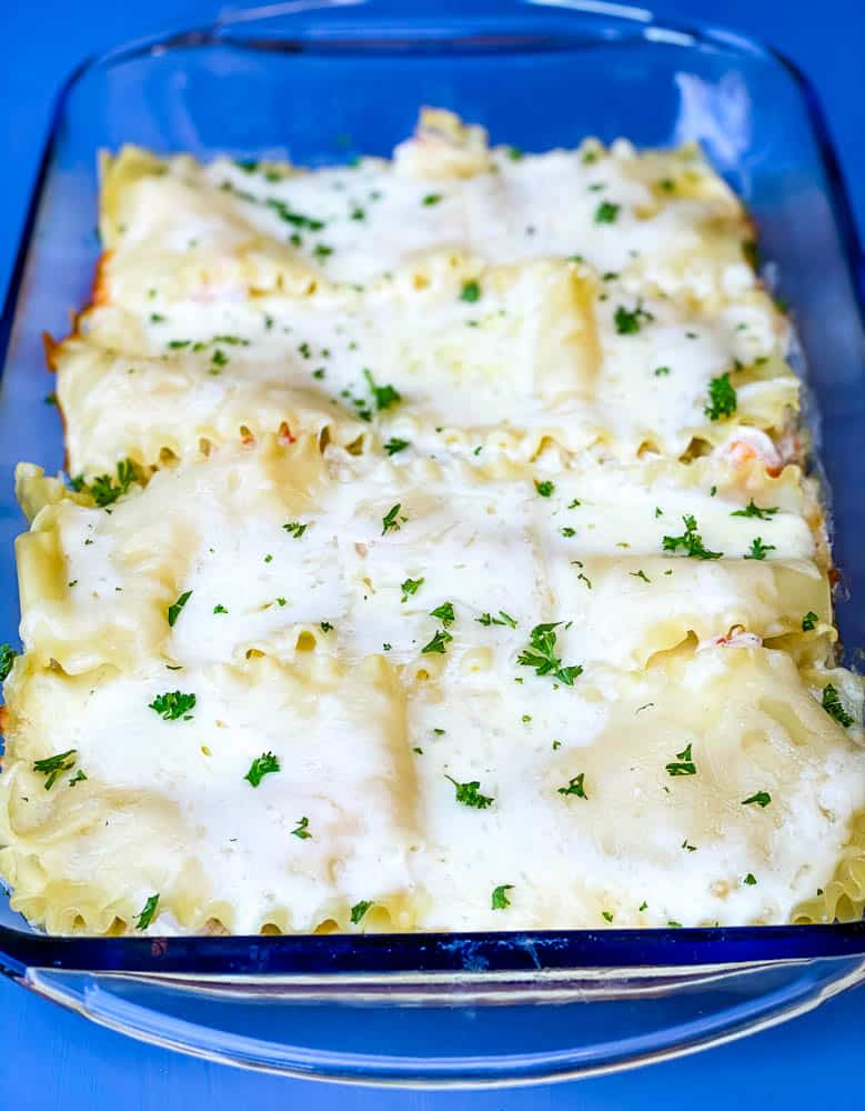 seafood lasagna in a glass baking dish